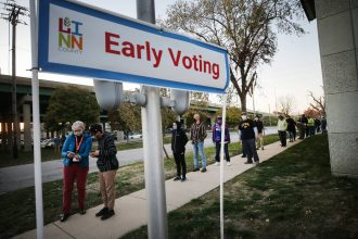 Voters wait in line to cast their ballots with social distance on the final day of early voting for the 2020 presidential election on Nov. 2, 2020 in Cedar Rapids, Iowa. Credit: Mario Tama/Getty Images