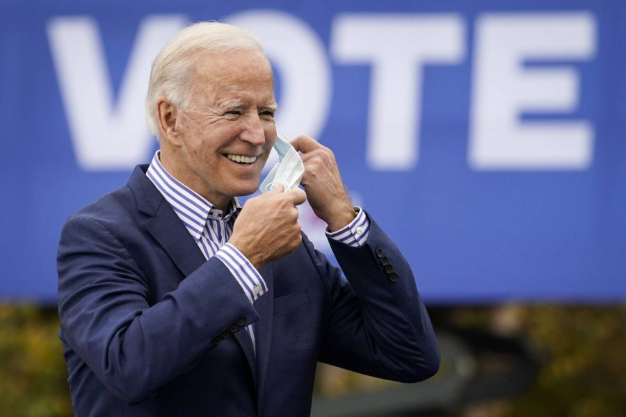 Joe Biden takes off his face mask to speak during a drive-in campaign rally at Bucks County Community College on Oct. 24, 2020 in Bristol, Pennsylvania. Credit: Drew Angerer/Getty Images