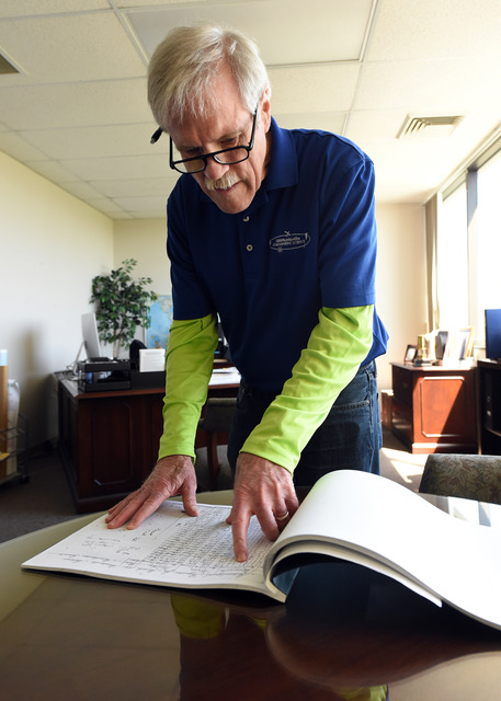 John Christy examines weather records recorded by Alabamians that date back to the late 1800s. Credit: Joe Songer/AL.com