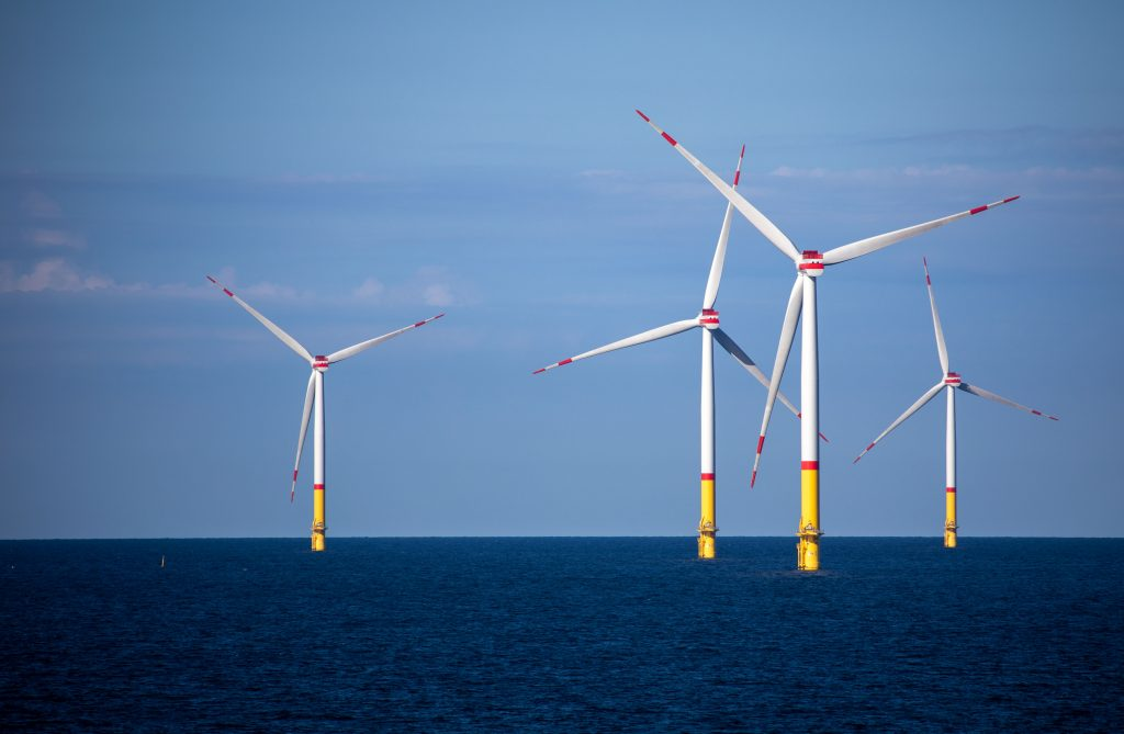 Wind turbines rotate in the Baltic Sea between the islands of Rügen and Bornholm in Denmark. Credit: Jens Büttner/picture alliance via Getty Images