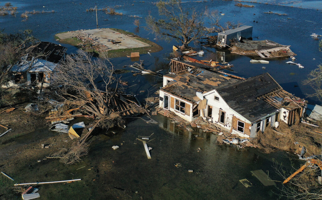 An aerial view of flood waters from Hurricane Delta surrounding structures destroyed by Hurricane Laura on October 10, 2020 in Creole, Louisiana.