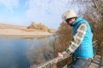 Jacob Katz, director of Central Valley operations for the conservation nonprofit California Trout, looks out on the Sacramento River, near the Rough and Ready Pumping Station.