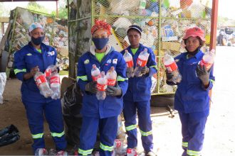 Waste pickers show Coca-Cola branded plastic waste collected in South Africa. Photo Courtesy of Break Free From Plastic