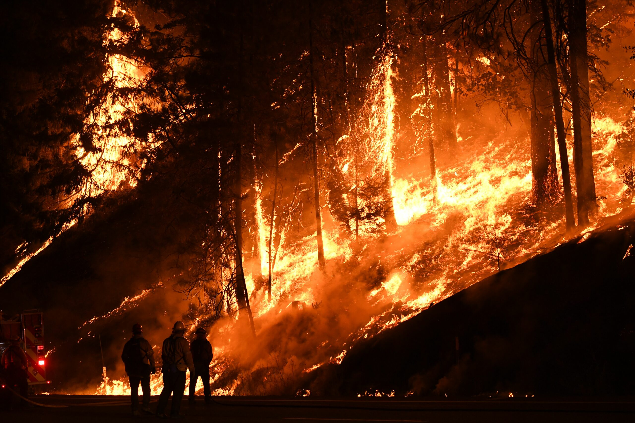 Firefighters use a back burn to try and control the Carr fire as it spreads towards the towns of Douglas City and Lewiston near Redding, California on July 31, 2018. The fire swept over the Iron Mountain Mine Superfund site, threatening to release corrosive chemicals into the watershed and contaminate Redding's water supply. Two firefighters were killed fighting the blaze and a 70 year old woman and her two great-grandchildren perished when their Redding home was swallowed by the flames. Credit: Mark Ralston/AFP via Getty Images