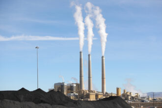 PacifiCorp's Hunter coal fired power pant releases steam as it burns coal outside of Castle Dale, Utah on Nov. 14, 2019. Credit: George Frey/AFP via Getty Images