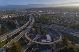 In May, as the Covid-19 pandemic swept cthe nation, normally jammed highways in Los Angeles were nearly empty. The absence of traffic led to steep reductions in carbon emissions, at least for a while. Credit: David McNew/Getty Images
