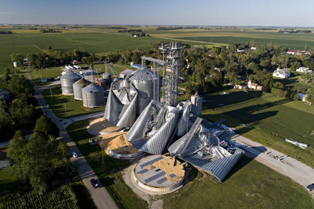 In this aerial image from a drone, damaged grain bins are shown at the Heartland Co-Op grain elevator on Aug. 11, 2020 in Luther, Iowa. Credit: Daniel Acker/Getty Images