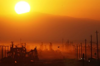 The sun rises over an oil field over the Monterey Shale formation where gas and oil is extracted using hydraulic fracturing, or fracking, on March 24, 2014 near Lost Hills, California. Credit: David McNew/Getty Images