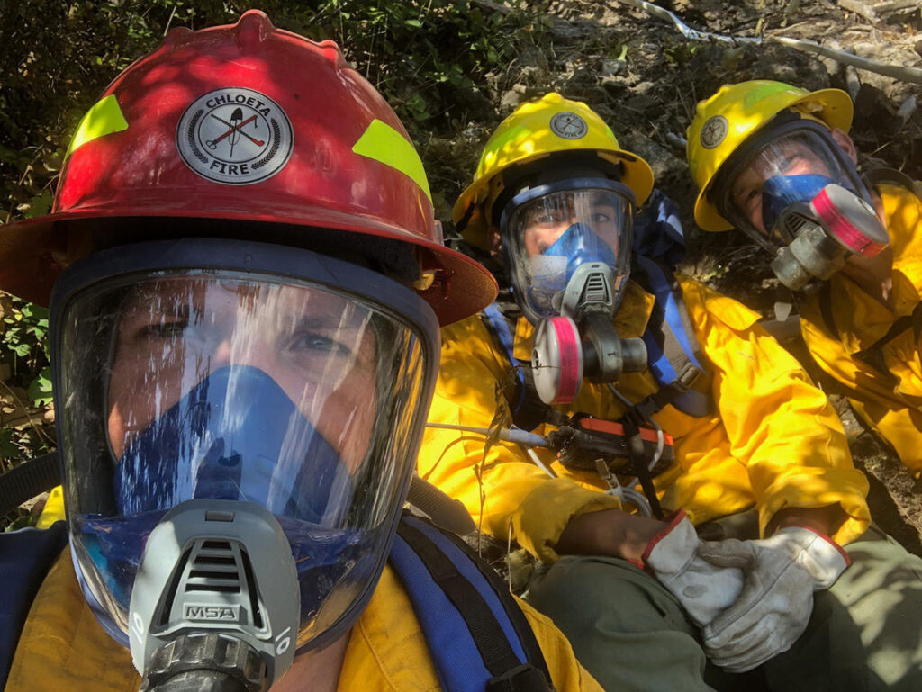 Nolan Buckingham, left, led a crew fighting the Highway 37 Fire outside Libby, Montana that included Jaime Garcia and Aaron Turner. The fire burned in a forest contaminated with asbestos, which required the firefighters to wear respirators. Photo Courtesy of Nolan Buckingham