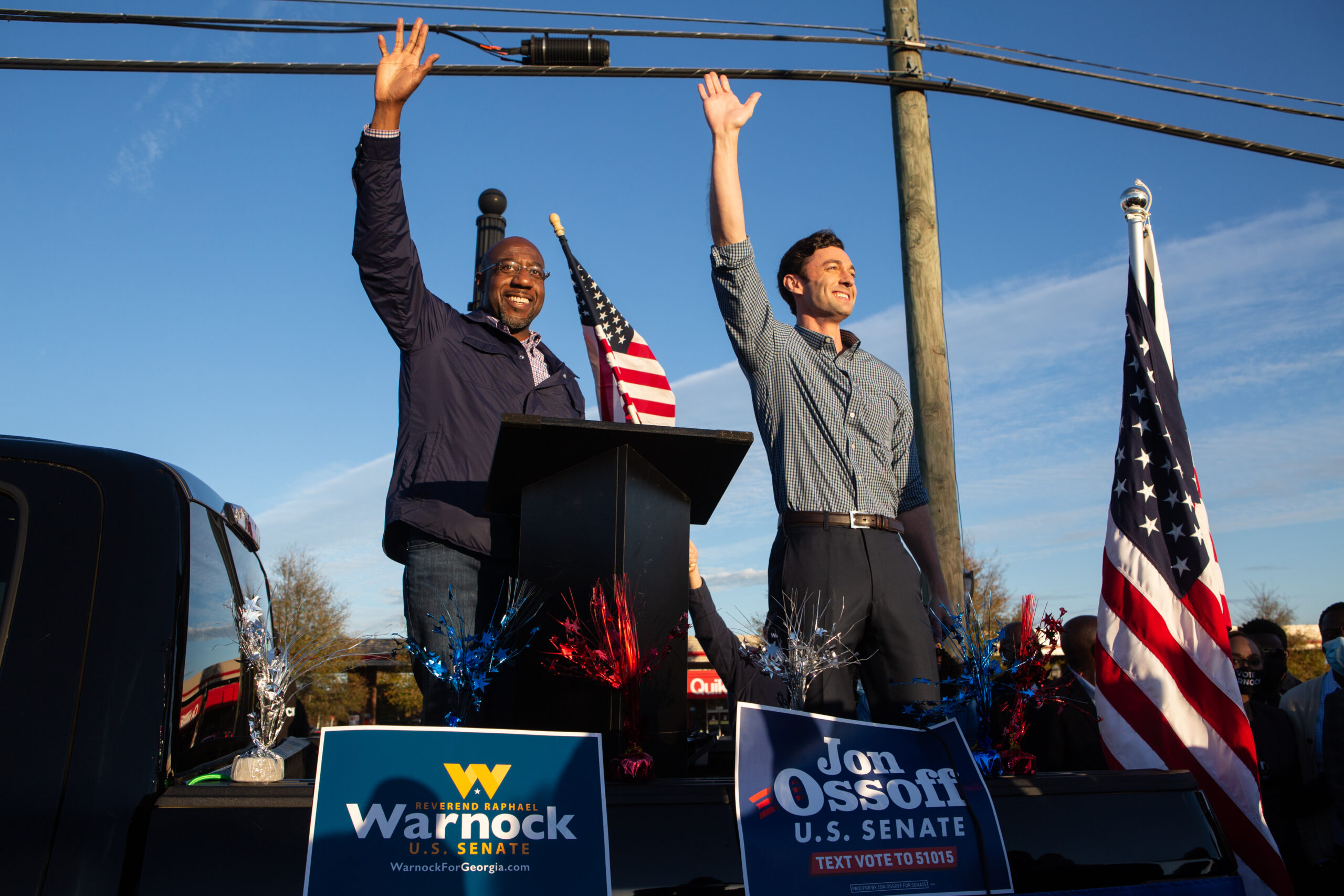Democratic Senate candidates Raphael Warnock (left) and Jon Ossoff of Georgia wave to supporters during a rally on Nov. 15, 2020 in Marietta, Georgia. Ossoff and Warnock face incumbent U.S. Sens. David Purdue (R-Georgia) and Kelly Loeffler (R-Georgia) respectively in a runoff election Jan. 5. Credit: Jessica McGowan/Getty Images