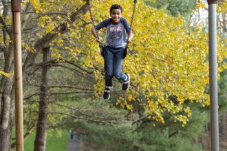 Ellington Tardy, 9, enjoys the playground in his Orchard Valley neighborhood Nov. 5, 2020 in Gaithersburg, Maryland. Credit: Katherine Frey/The Washington Post via Getty Images