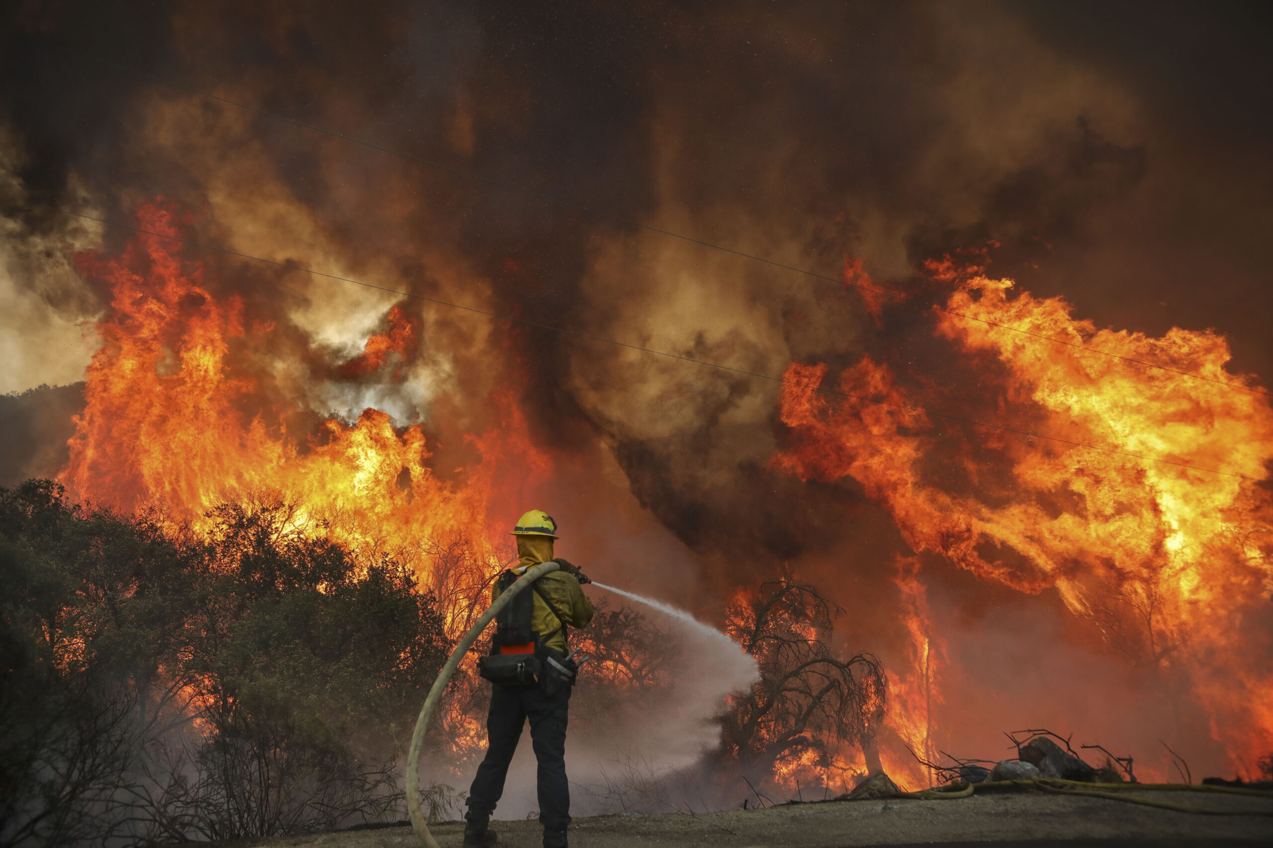 San Miguel County Firefighters battle a brush fire along Japatul Road during the Valley Fire in Jamul, California on Sept. 6, 2020 Credit: Sandy Huffaker/AFP via Getty Images