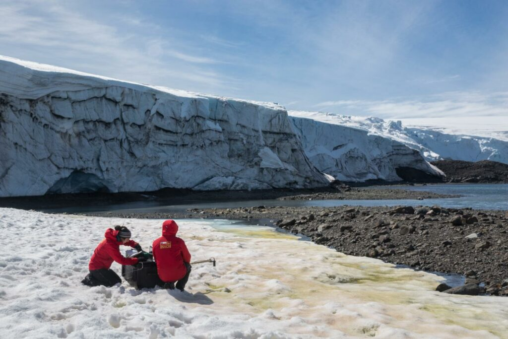 Dr. Alia Khan and Chilean colleague Edgardo Sepulveda collect spectra albedo measurements in front of Collins Glacier on King George Island. Credit: Gonzalo Barrera