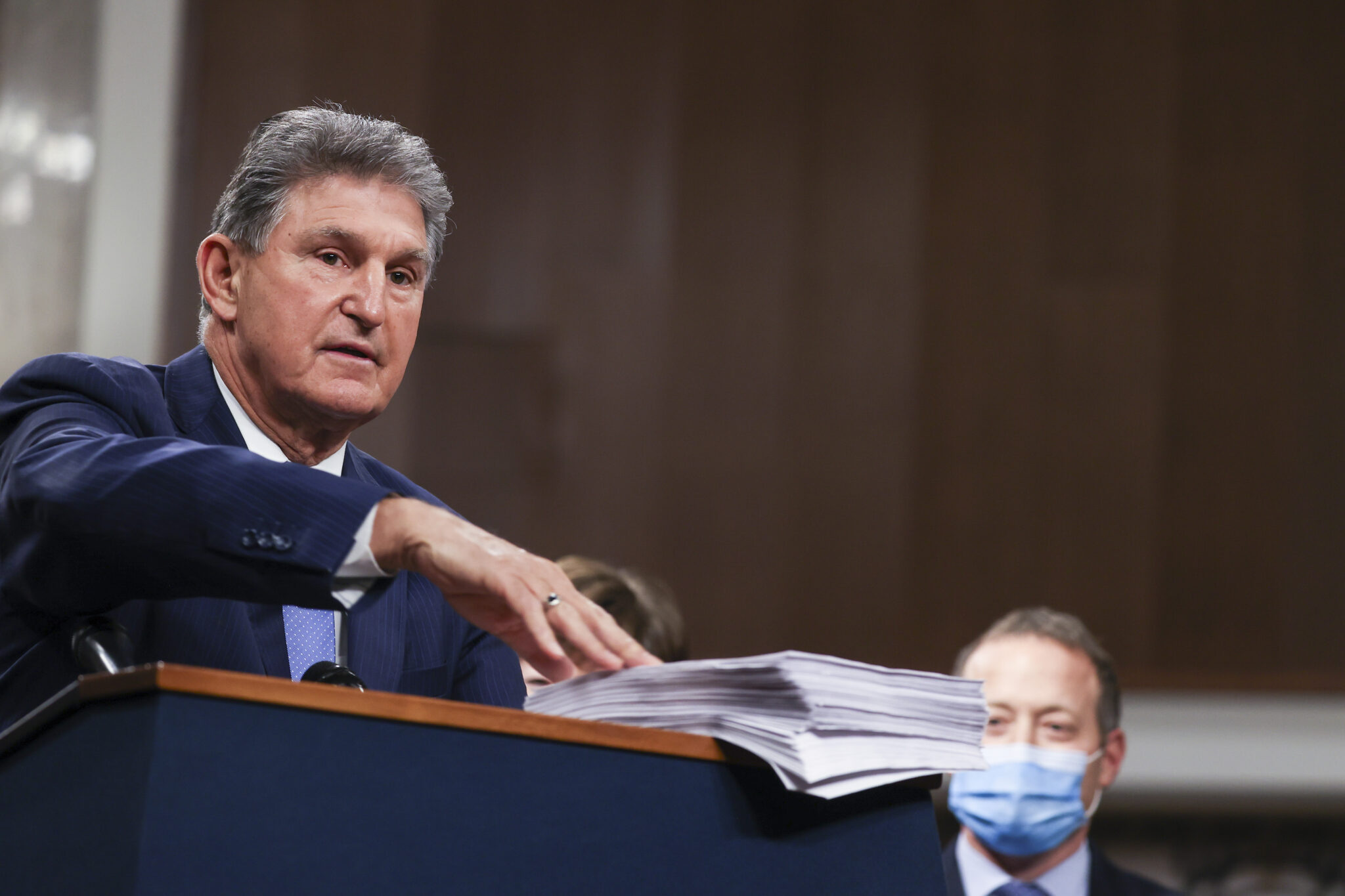 Sen. Joe Manchin (D-W.V.) speaks alongside a bipartisan group of Democrat and Republican members of Congress as they announce a proposal for a Covid-19 relief bill on Capitol Hill on Dec. 14, 2020 in Washington, D.C. Credit: Tasos Katopodis/Getty Images