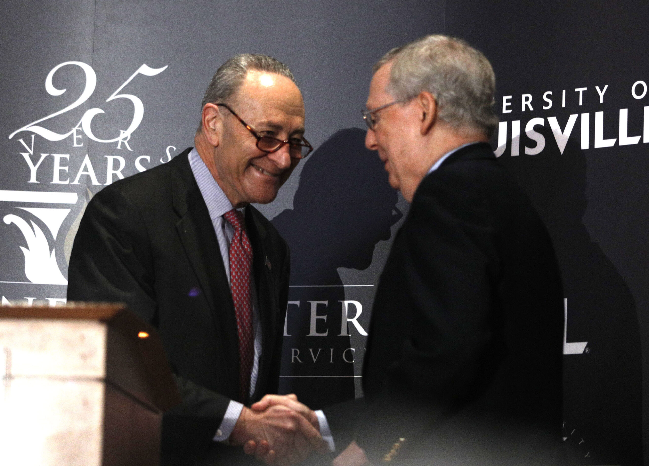 Senate Majority Leader Mitch McConnell (right) (R-Ky.) and Senate Democratic Leader Chuck Schumer (D-N.Y.) shake hands after Schumer delivered a speech and answered questions at the University of Louisville's McConnell Center Feb. 12, 2018 in Louisville, Kentucky. Credit: Bill Pugliano/Getty Images