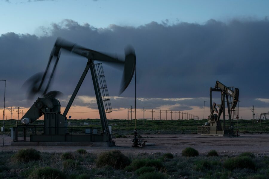 Pump jacks operate at dusk near Loco Hills on April 23, 2020 in Eddy County, New Mexico. Credit: Paul Ratje/AFP via Getty Images