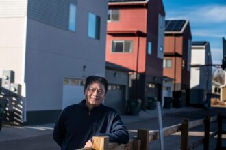 """Dar-Lon Chang, who was an engineer for ExxonMobil for more than 15 years, left his career in the fossil fuel industry in Houston and moved to the Geos Neighborhood in Arvada, Colorado with his wife and daughter. """"I just wanted to go all the way and be a part of a community where my daughter could live fossil fuel-free and net-zero,"""" he said. """"So she could see it was possible."""" Credit: Michael Kodas/Inside Climate News"""