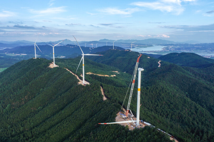 Workers install wind turbines at Yuxia wind farm on mountain on June 15, 2020 in Ji'an, Jiangxi Province of China. Credit: Chen Fuping/VCG via Getty Images