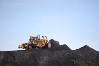 Heavy equipment moves coal into piles at PacifiCorp's Hunter coal fired power pant outside of Castle Dale, Utah on Nov. 14, 2019. credit: George Frey/AFP via Getty Images