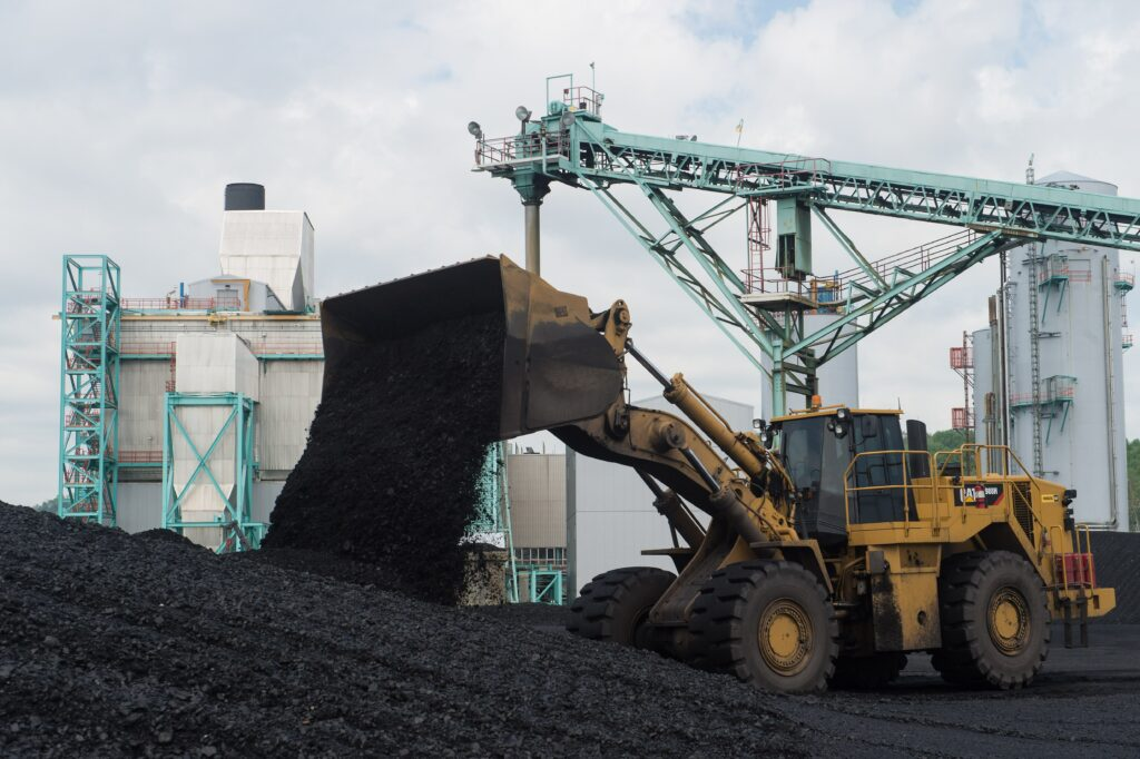 A front-end loader dumps coal at the East Kentucky Power Cooperative's John Sherman Cooper power station near Somerset, Kentucky, on April 19, 2017.  Credit: Nicholas Kamm/AFP via Getty Images