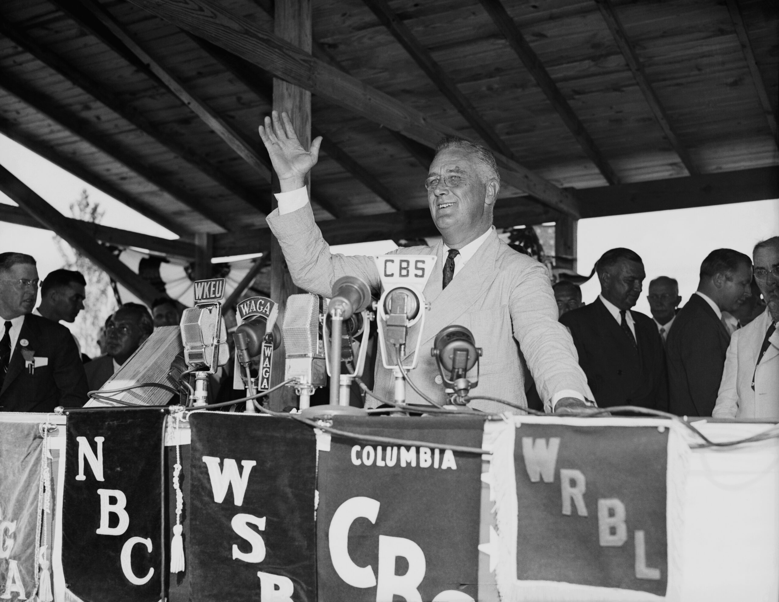 President Roosevelt delivers a speech at the dedication of the U.S. Rural Electrification Project. Credit: Getty Images