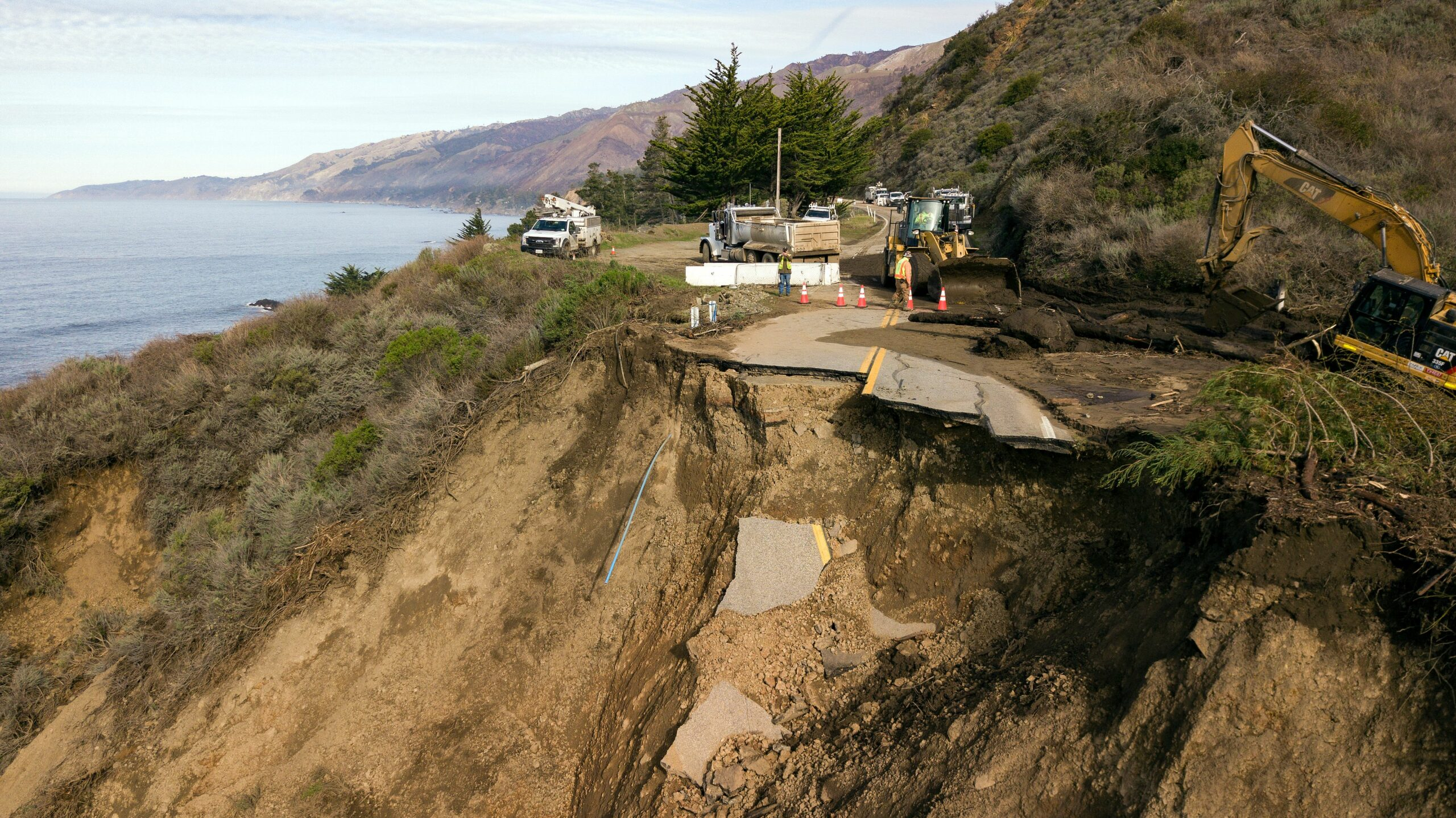 Construction crews work at the scene where a section of Highway 1 collapsed into the Pacific Ocean near Big Sur, California on Jan. 31, 2021. Credit: Josh Edelson/AFP via Getty Images
