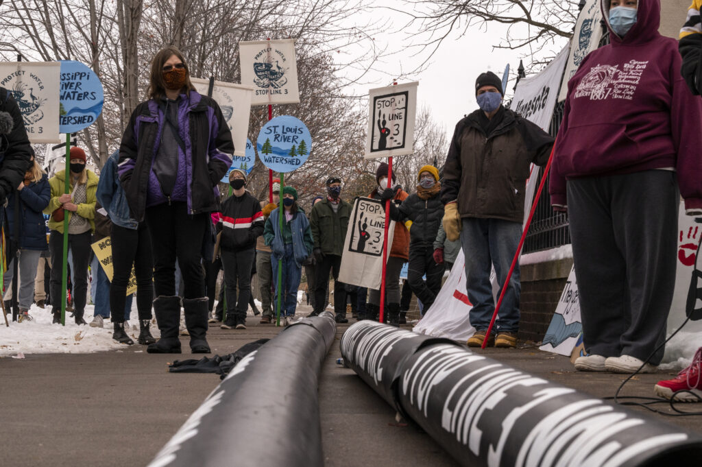 People protest against the Enbridge Energy Line 3 oil pipeline project outside the Governor's Mansion on November 14, 2020 in St Paul, Minnesota. Credit: Stephen Maturen/Getty Images