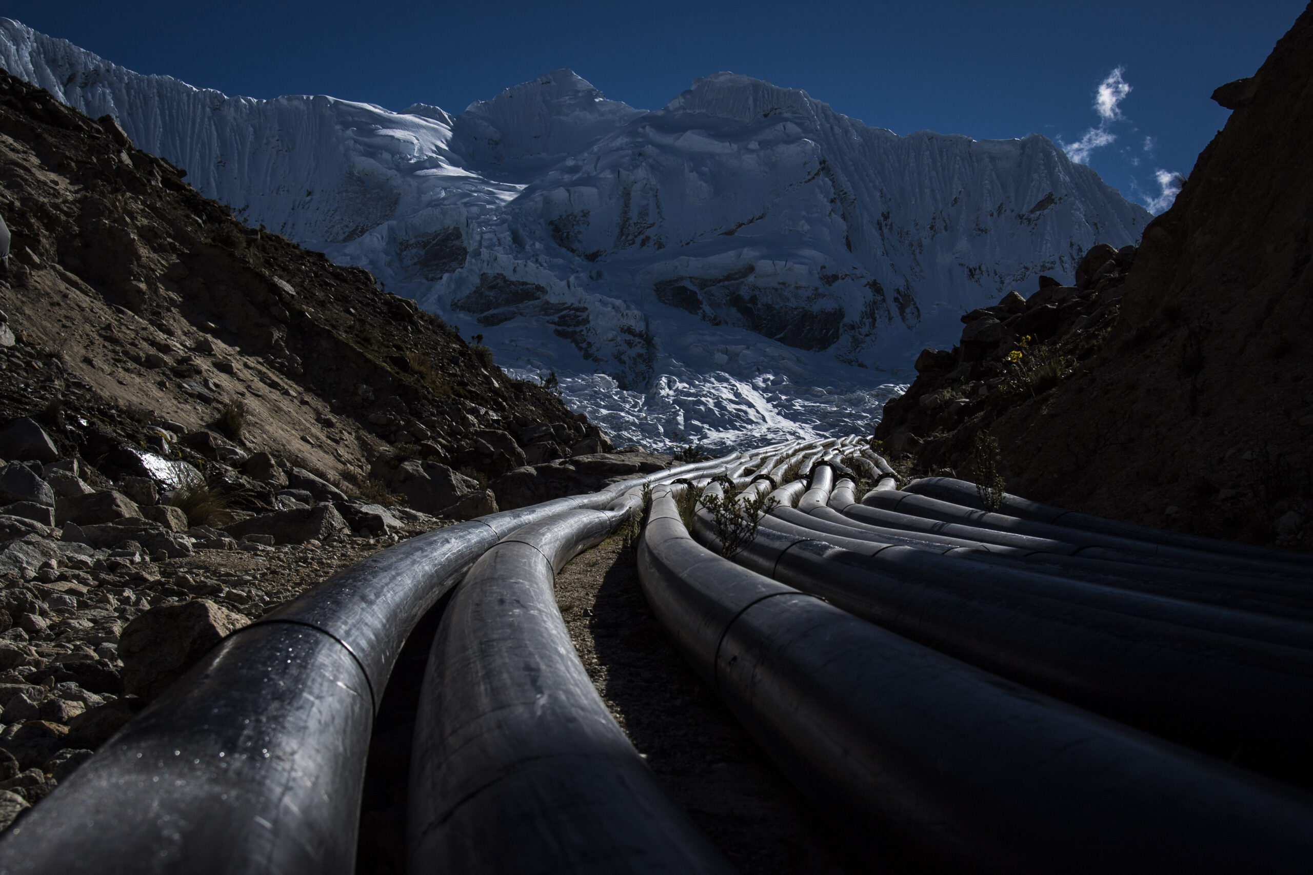 Siphon pipes lead up the mountain to Laguna Palcacocha, a swollen glacial lake in the Andes mountain range in the Ancash Region of Peru on Wednesday, July 12, 2017. The siphons were installed to reduce the volume of the lake and to try and prevent a dam rupture but were damaged in the recent icefall an only two still work. Credit: Jabin Botsford/The Washington Post via Getty Images