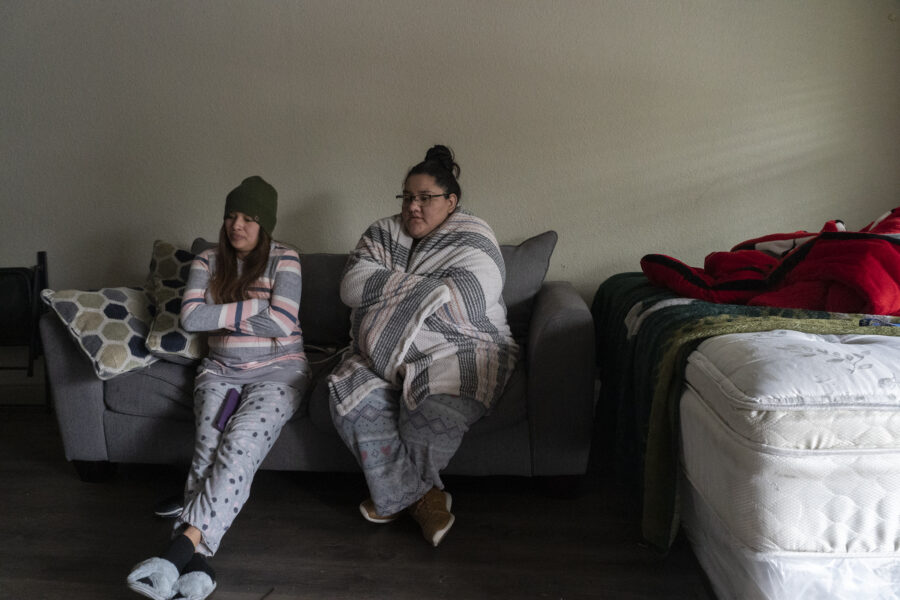 Karla Perez and Esperanza Gonzalez stay in their apartment during power outage caused by the winter storm on Feb. 16, 2021 in Houston, Texas. A winter storm has brought historic cold weather, power outages and traffic accidents to Texas. Credit: Go Nakamura/Getty Images