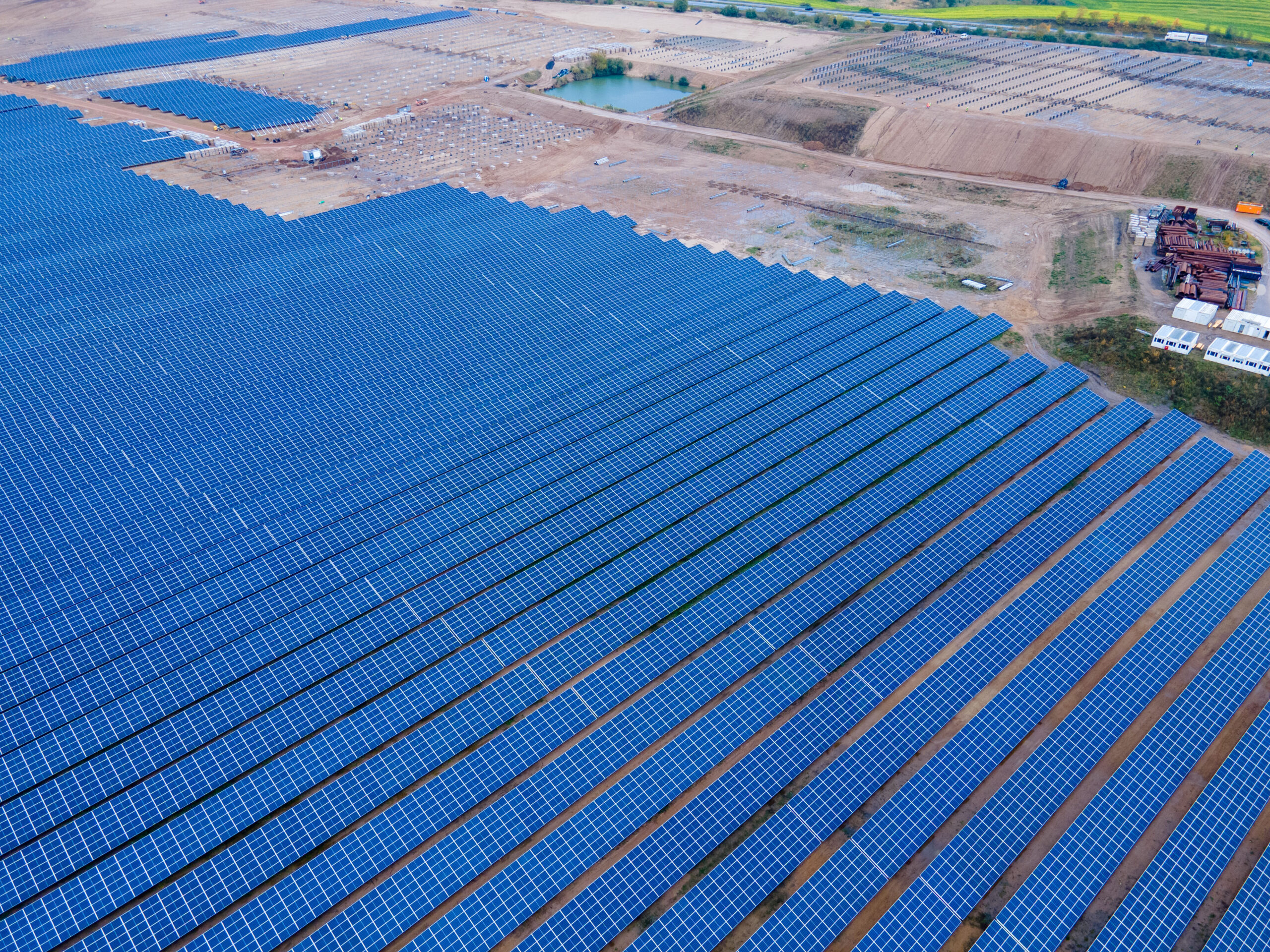Employees of the Goldbecksolar company stand in a solar park. Credit: Jens Büttner/picture alliance via Getty Images