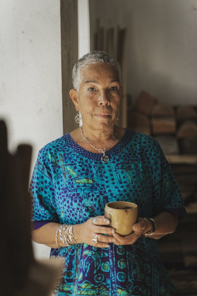 Frandelle Gerard poses for a portrait at the Crucian Heritage and Nature Tourism Foundation Cultural Center, where she works as the foundation's executive director. Gerard testified in 2018 against the proposal to reopen the Limetree Bay oil refinery, saying the facility poisoned the island's only aquifer. Credit: Michael Butler