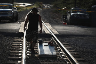 Chris Rowe, an unemployed Blackjewel coal miner, mans a blockade of the railroad tracks that lead to the mine where he once worked on Aug. 24, 2019 in Cumberland, Kentucky. More than 300 miners in Harlan County unexpectedly found themselves unemployed when Blackjewel declared bankruptcy and shut down their mining operations. Credit: Scott Olson/Getty Images