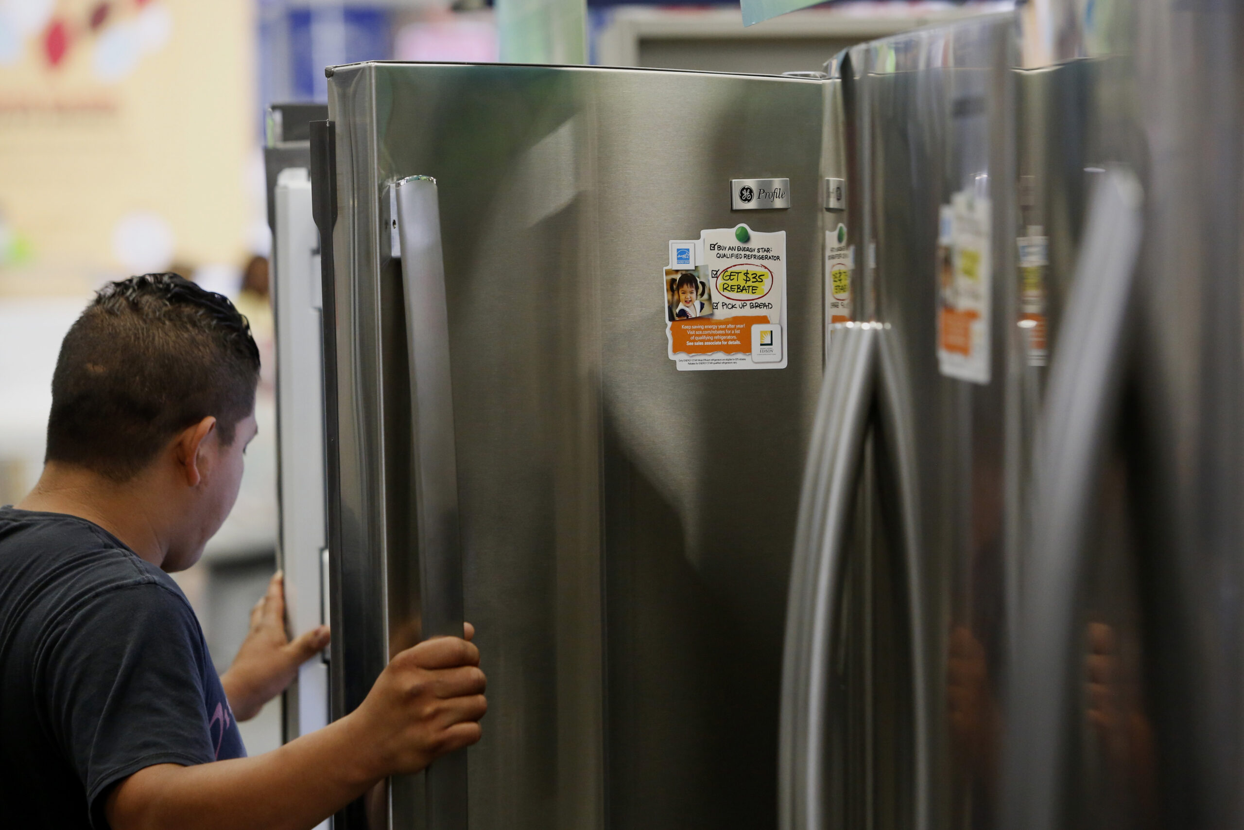 A man views a General Electric refrigerator displayed for sale at a Lowe's Cos. store in Torrance, California. Credit: Patrick T. Fallon/Bloomberg via Getty Images