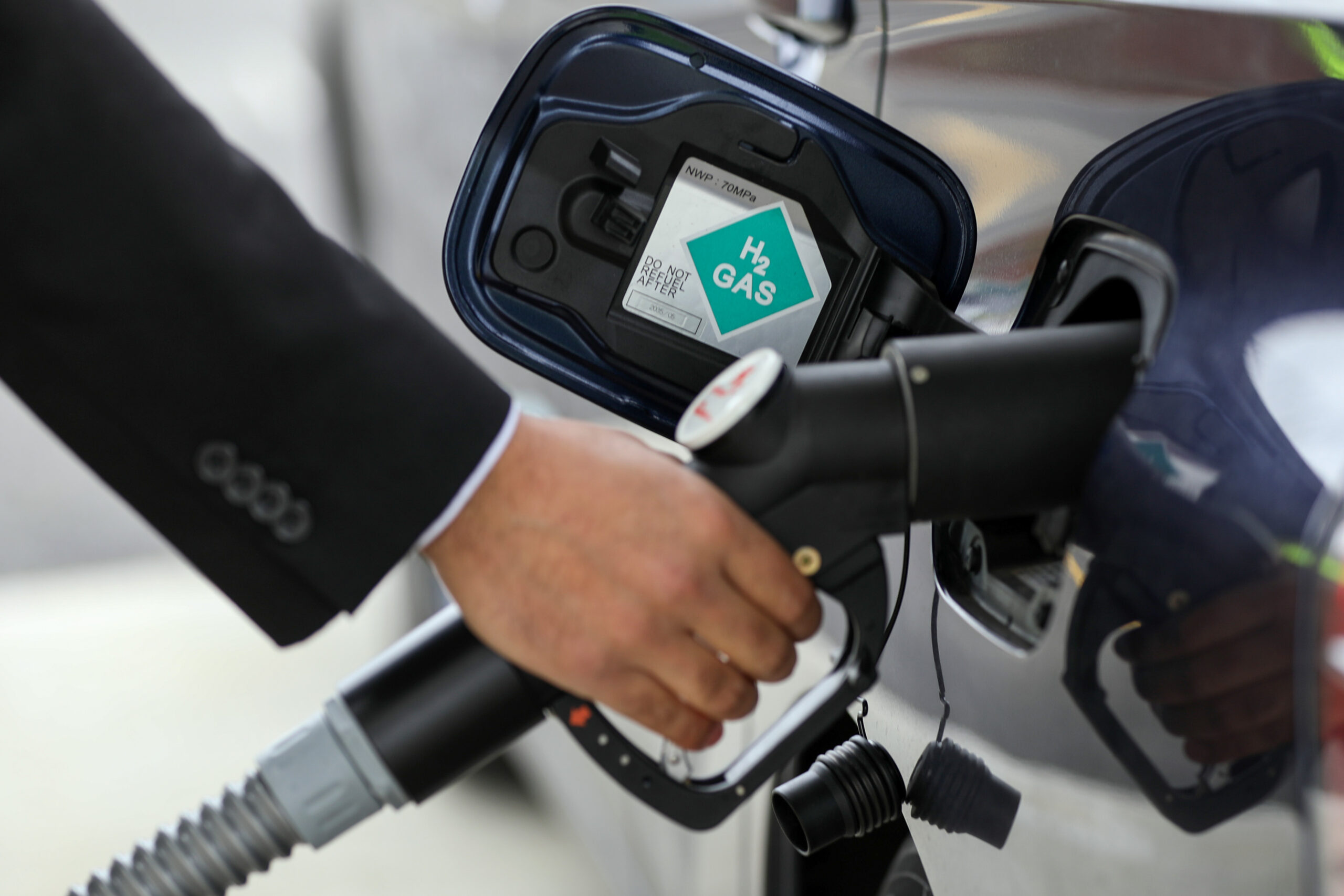 A driver places a hydrogen fuel pump into a Mirai hydrogen fuel powered automobile, manufactured by Toyota Motor Corp., at Royal Dutch Shell Plc's first U.K. hydrogen refueling station in Cobham, U.K., on Wednesday, Feb. 22, 2017. Credit: Chris Ratcliffe/Bloomberg via Getty Images