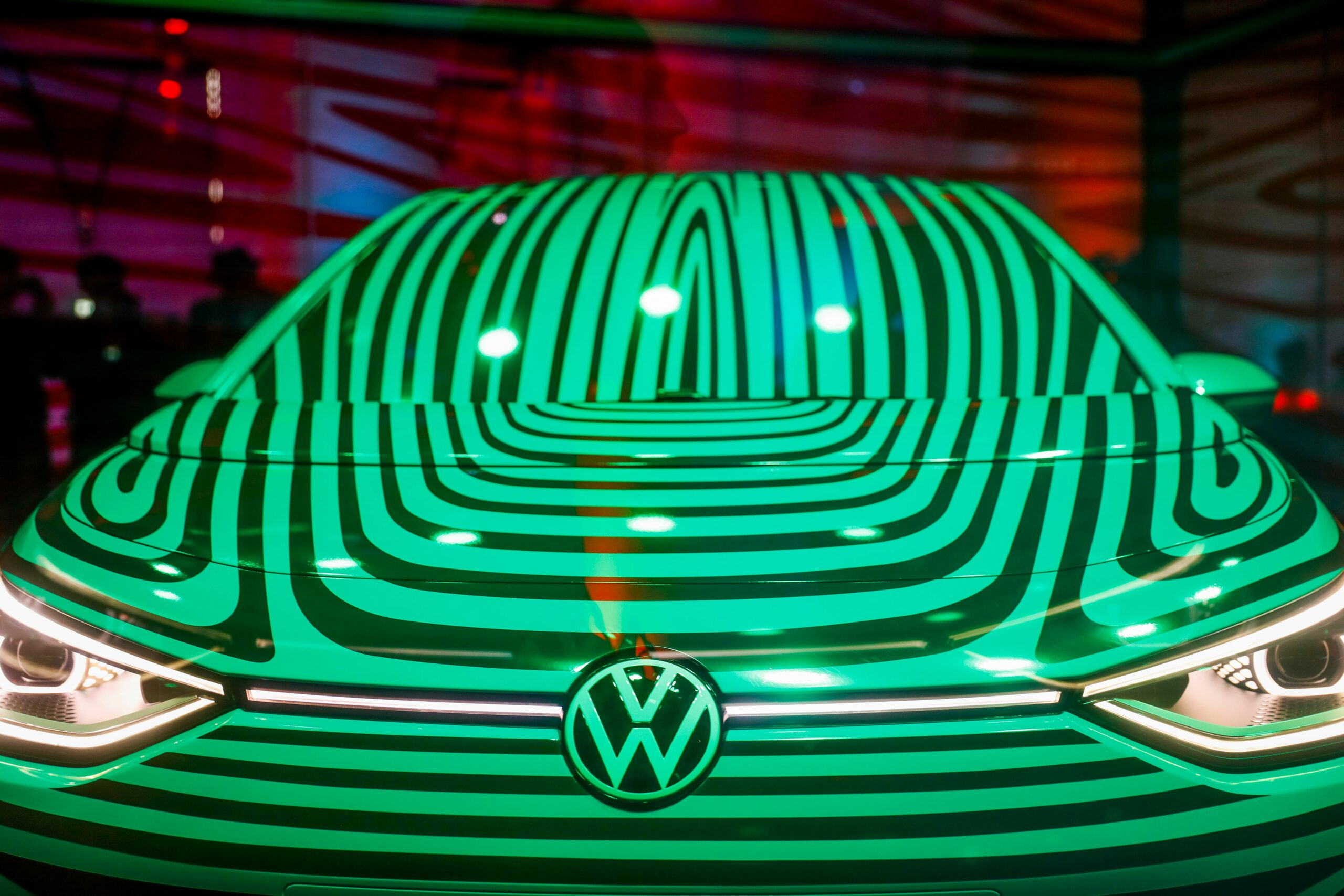 A Volkswagen ID 3 electric car is seen in a glass cage during a press conference in Berlin on May 8, 2019. Credit: Odd Andersen/AFP via Getty Images