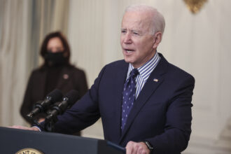 President Joe Biden speaks in the State Dining Room of the White House, March 6, 2021, in Washington D.C. Credit: Oliver Contreras/For The Washington Post via Getty Images