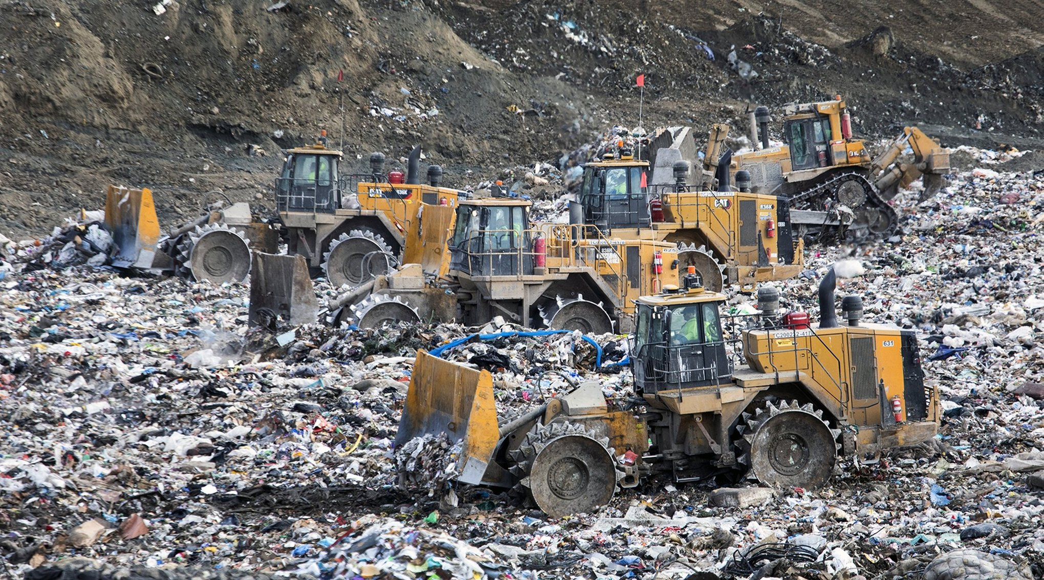 Each day more than 12 million pounds of garbage is dumped, spread, compacted and finally covered with a layer of dirt at the Klickitat County landfill owned by Republic Services. It sits on a plateau above the Columbia River in southern Washington. Credit: Steve Ringman / The Seattle Times