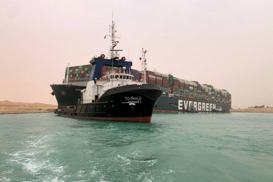 A handout picture released by the Suez Canal Authority on March 24, 2021 shows a part of the Taiwan-owned MV Ever Given (Evergreen), a 1,300-foot-long vessel, lodged sideways and impeding all traffic across the waterway of Egypt's Suez Canal. Credit: Suez Canal Authority/Handout/AFP via Getty Images