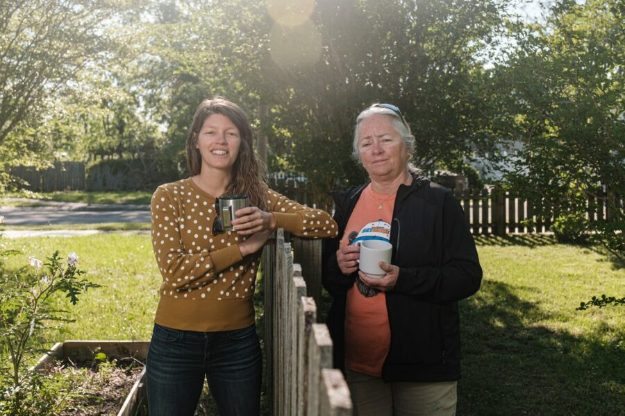 Neighbors Kelly Hagen (left) and Dixie Wilkinson stand in their respective yards on April 22, 2021 in Pensacola, Florida. Their homes are located next to the now closed American Creosote Works, now an EPA Superfund site which is causing environmental problems for the area and health problems for the residents who live near it. Credit: Dan Anderson