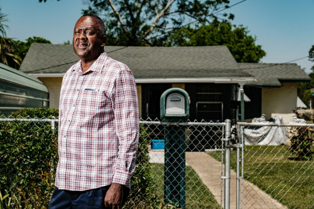 Air Force Veteran Victor Alexander poses for a photo in front of his childhood home on April 22, 2021 in Pensacola, Florida.  Alexander grew up in the Tan Yard, a Black neighborhood located close to American Creosote Works, now an EPA Superfund site. Credit: Dan Anderson