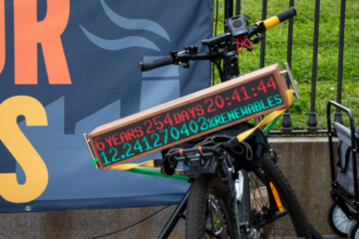 """The portable """"climate clock"""" sits on one of the bikes in from of the White House in Washington D.C. Credit: Alicia Diaz"""
