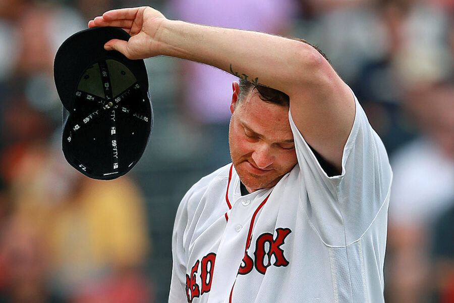 Red Sox starting pitcher Steven Wright is feeling the heat in the top of the fourth inning on Aug. 31, 2016 at Fenway Park in Boston. Credit: Jim Davis/The Boston Globe via Getty Images