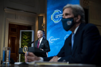 President Joe Biden delivers remarks as Special Presidential Envoy for Climate and former Secretary of State John Kerry listens during a virtual Leaders Summit on Climate with 40 world leaders at the East Room of the White House April 22, 2021 in Washington, D.C. Credit: Al Drago-Pool/Getty Images