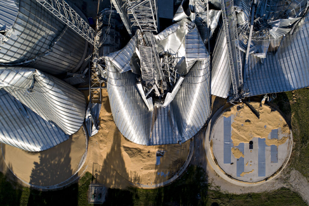 Damaged grain bins are shown at the Heartland Co-Op grain elevator in Luther, Iowa following the derecho that tore through the Midwest on Aug. 10, 2020. Credit: Daniel Acker/Getty Images