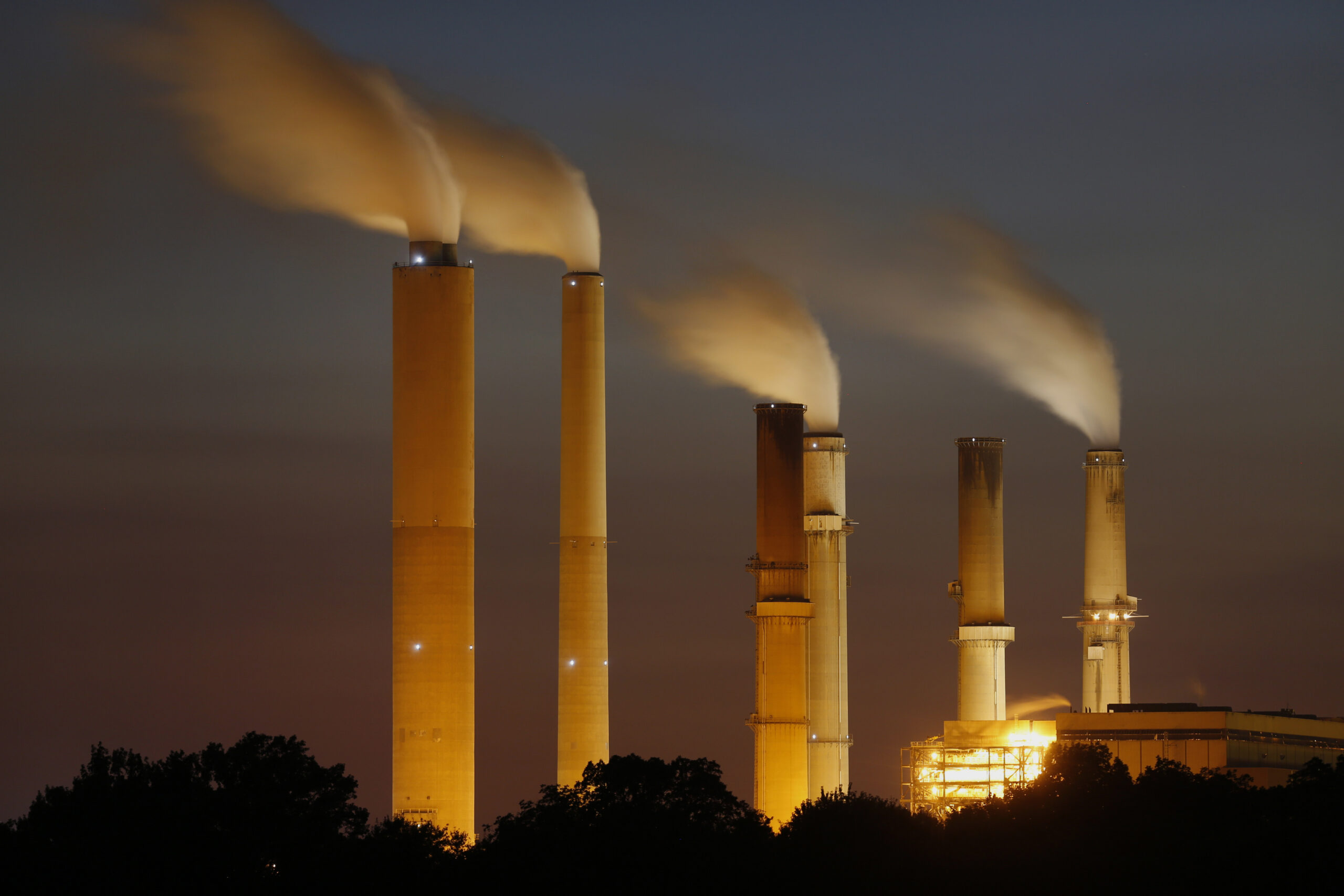 Emissions rise from stacks the Duke Energy Corp. Gibson Station power plant at dusk in Owensville, Indiana, on Thursday, July 23, 2015. Credit: Luke Sharrett/Bloomberg via Getty Images