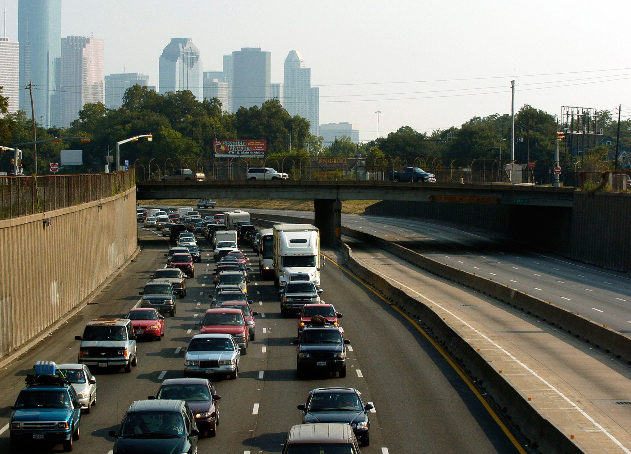With the downtown skyline in the background cars jam the northbound lanes of I-45 in Houston, Texas. Credit: Stan Honda/AFP via Getty Images