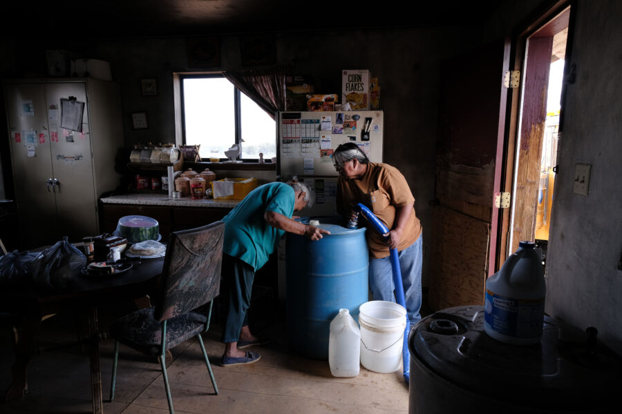 Nancy Bitsue, an elderly member of the Navajo Nation, receives her monthly water delivery in the town of Thoreau on June 6, 2019 in Thoreau, New Mexico. Credit: Spencer Platt/Getty Images