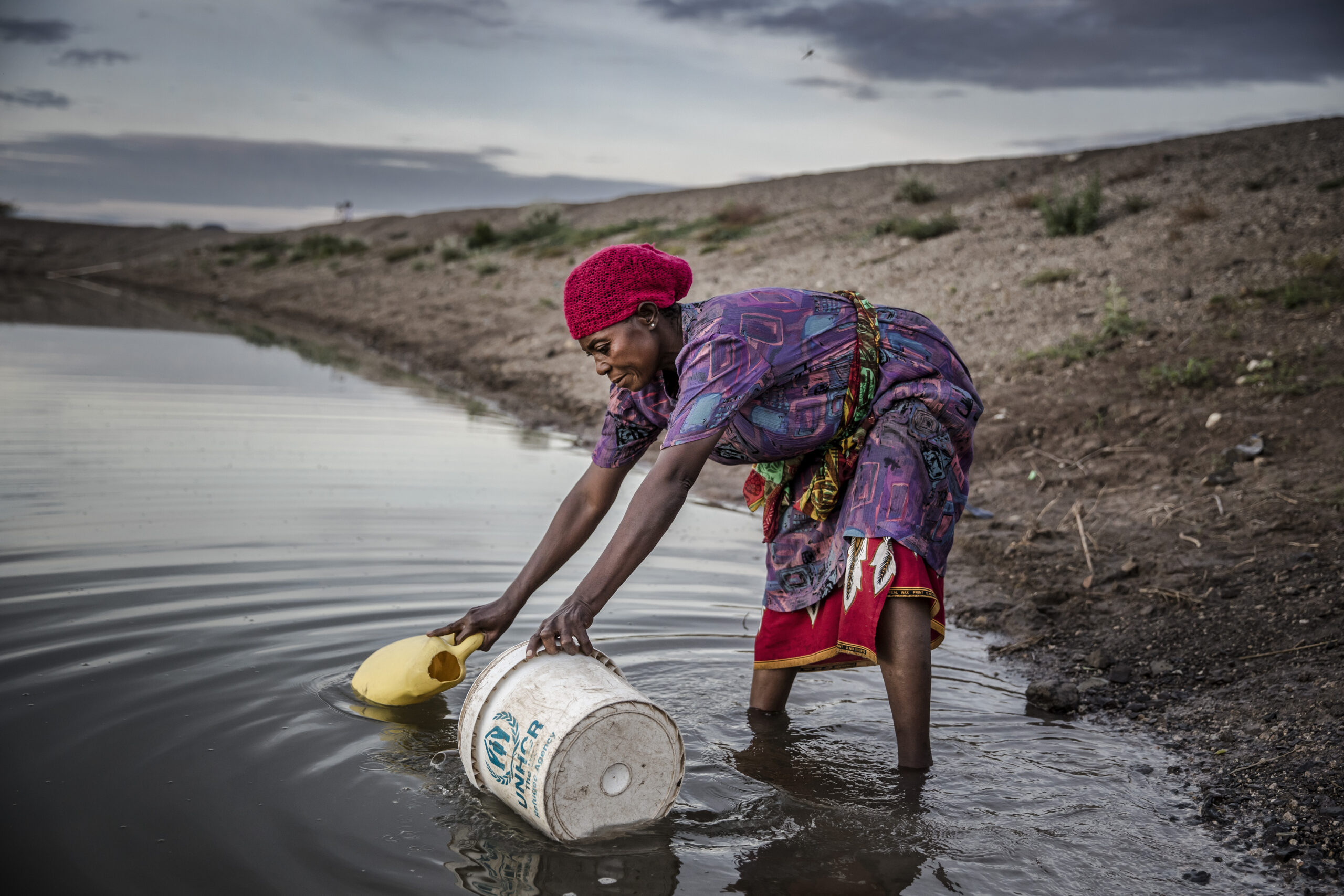 A refugee from Democratic Republic of Congo, collects water for their vegetable crops at a water pan in Kalobeyei settlement for refugees in Turkana County, Kenya on October 2, 2019. Credit: Luis Tato/AFP via Getty Images