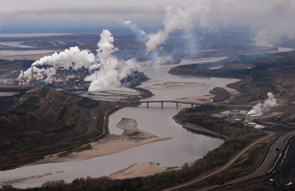 Aerial view of the Suncor oil sands extraction facility on the banks of the Athabasca River and near the town of Fort McMurray in Alberta, Canada on Oct. 23, 2009. Credit: Mark Ralston/AFP via Getty Images