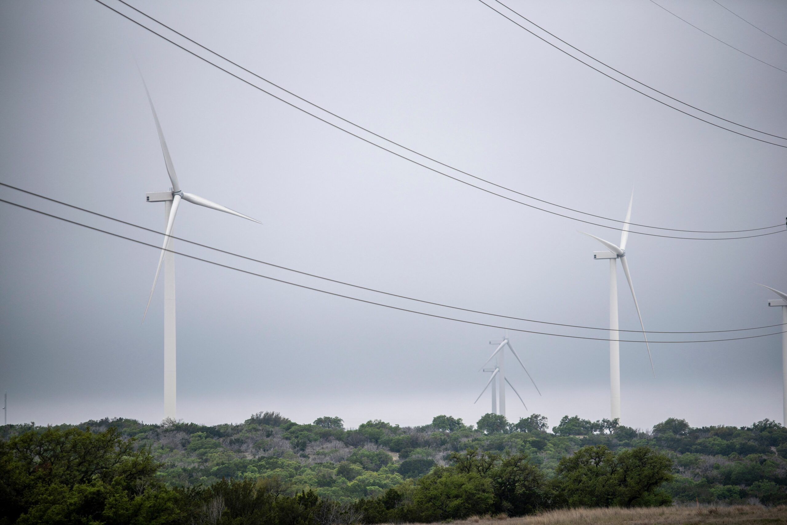 Blades from a wind turbine rotate in a field, April 16, 2021 near Eldorado, Texas. Credit: Sergio Flores/AFP via Getty Images